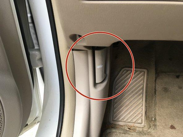 Locate the Hood Latch in the car door.