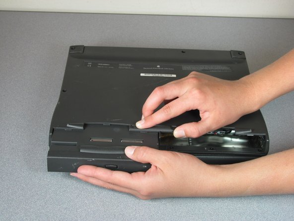 Continue holding the latch then gently pull the CD-ROM Drive out of the device.