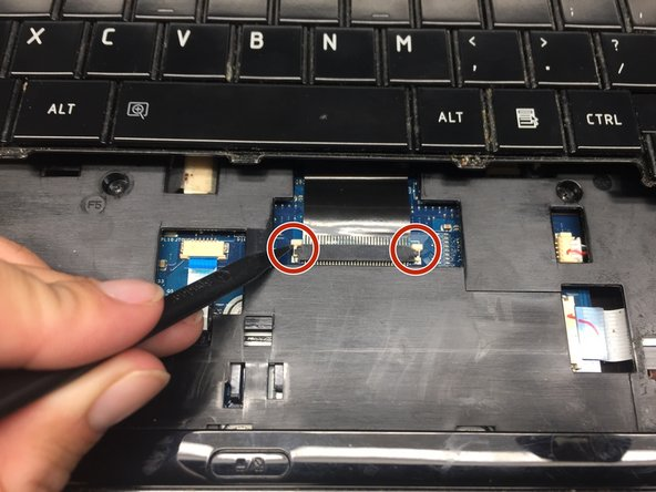 Image 1/3: Carefully slide the connector out of the port.