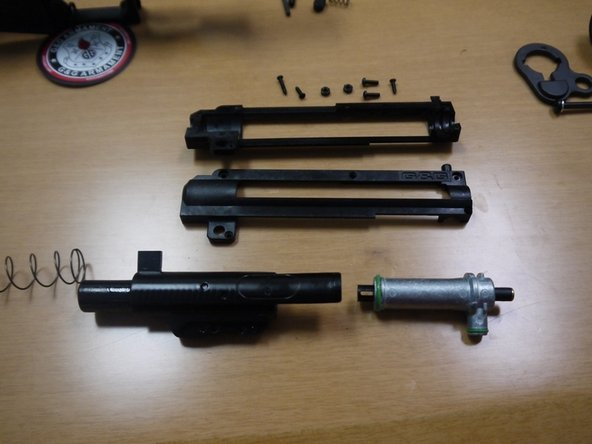 Remove the bolt, recoil spring, and nozzle assembly from the shell.