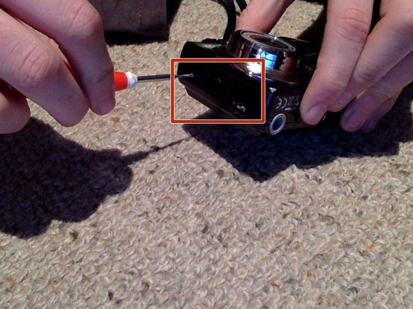 First you want to remove the 7 Philips Head Screws from the exterior of the camera