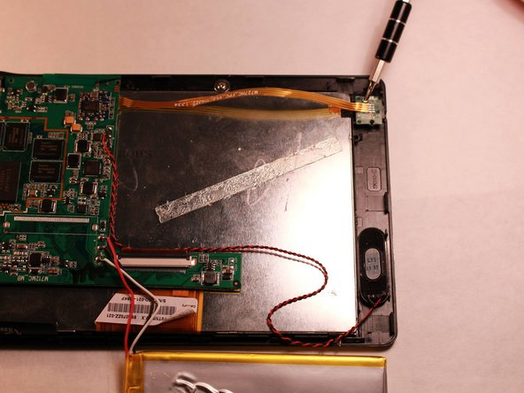 Remove both screws on either side of the audio jack using the Philips head screwdriver.
