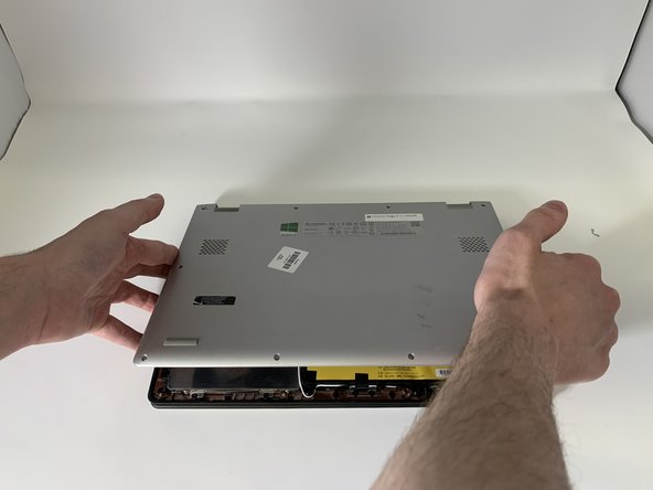 Carefully remove the back panel by gently prying the panel from the front to the back.