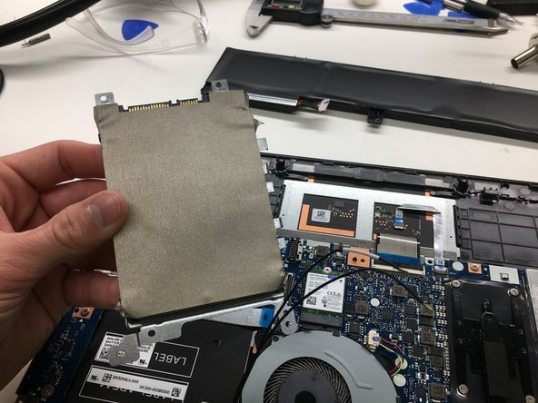 Remove the drive from the laptop.