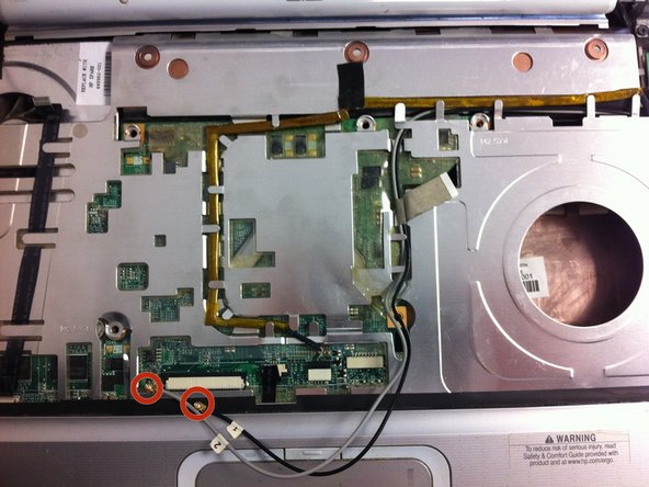Image 1/3: Proceed to  pull the two WiFi antenna cables through the motherboard.