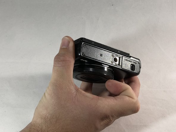 Flip the camera over to reveal the battery cover.