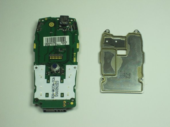Remove the plate from the circuit board protecting the more delicate processing parts.