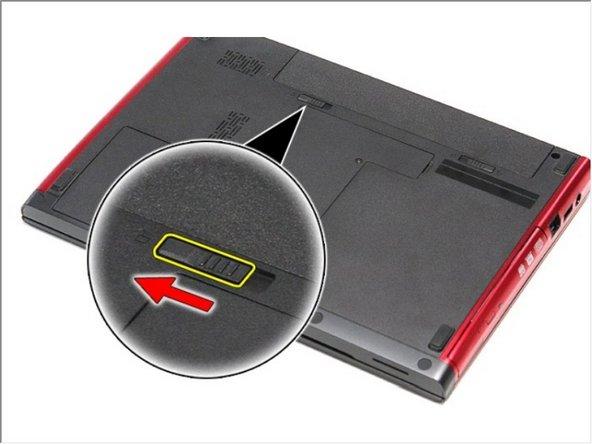 Deslice el otro pestillo de liberación de la batería a la posición de desbloqueo.
