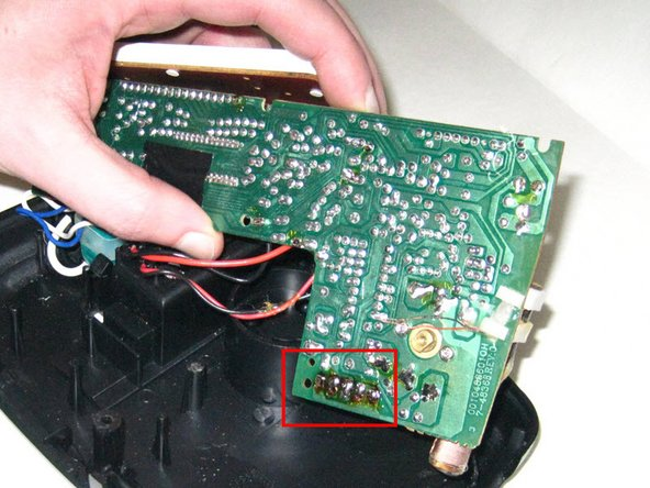 Image 3/3: Gently and firmly push on the pins with the Spudger to remove the switch from the underside of the PCB.
