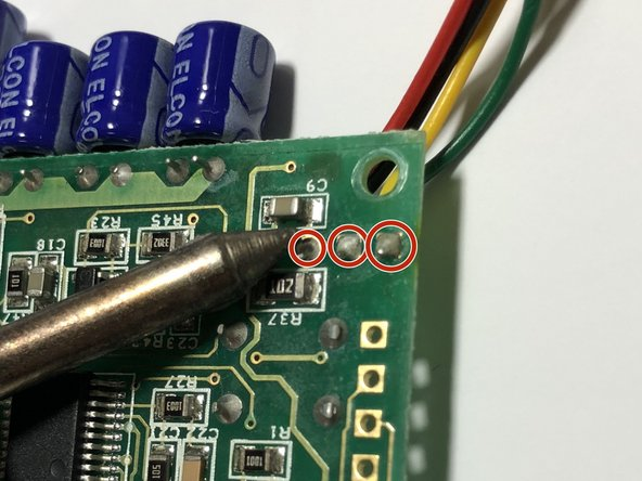 With a Soldering Iron, desolder the four cables that connect the charging cable to the circuit board.