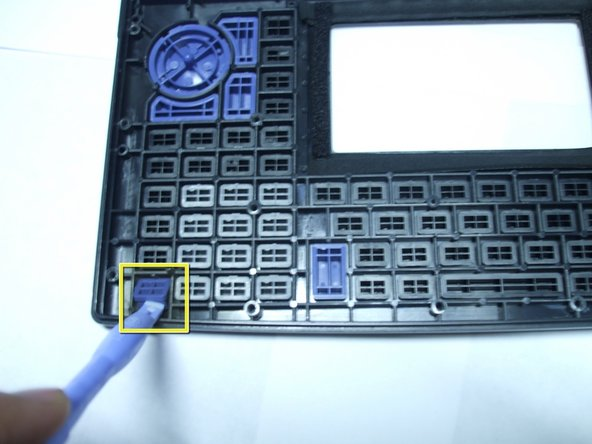 Image 1/1: To aid the removal of individual keys you can use the Ipod Opening Tool or preferably a pair of tweezers.