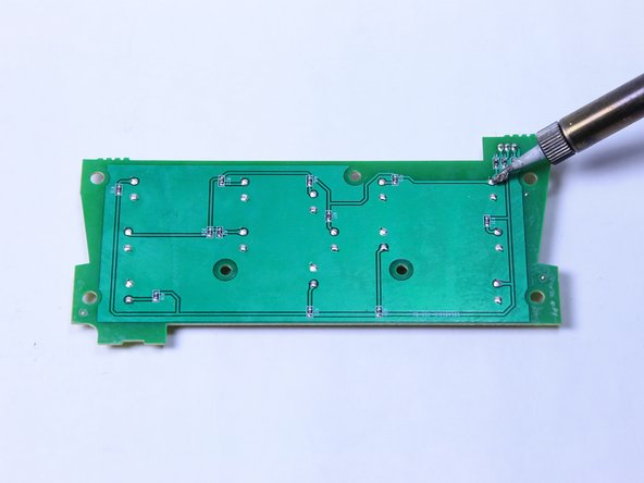 Image 2/3: The buttons will be labeled on the top of the circuit board, and you will be working with the corresponding connections on the back.