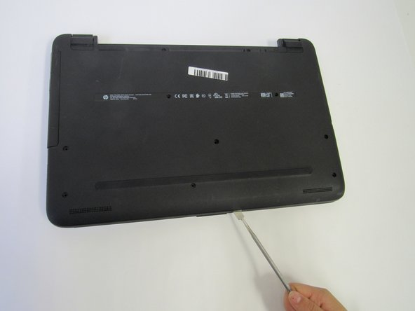Use an opening tool and wedge it under the edge and go around the whole laptop to help remove the back cover.