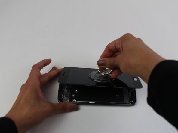 Using a heat gun on a low setting, slowly raise the temperature of the screen by repeatedly running the heat gun along the edges of the screen. This will soften the glue that holds the screen to the phone frame.