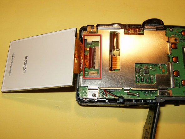 Gently remove the LCD from the holder and just flip it to the side. Do not remove it yet. You will have to loosen the clip on the connector. Use your fingernails to move it in the opposite direction from the LCD, this will open it up. Remove the LCD and replace with new one.