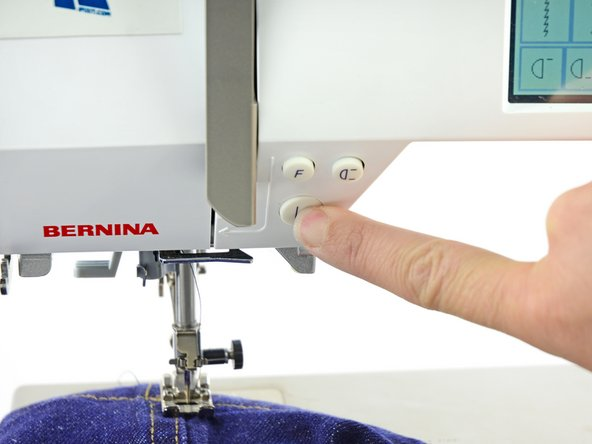 Image 2/2: Use the reverse function on your sewing machine to backstitch a couple of stitches.