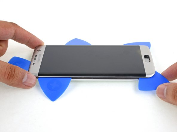 Use the opening picks to slice through adhesive around the home button and any other remaining adhesive.