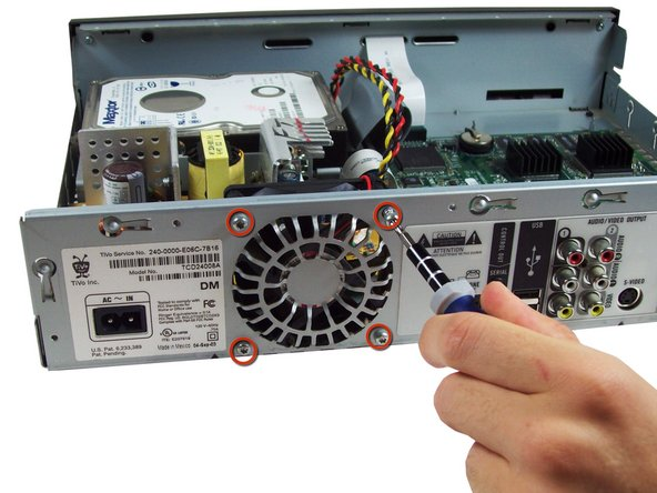 Remove the four 0.31 inch T-9 screws and gently pull fan out.