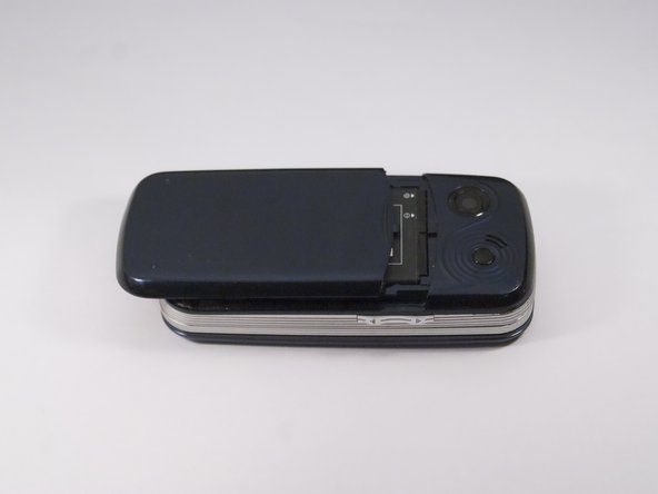 Gently slide the backside phone cover off exposing the battery underneath.