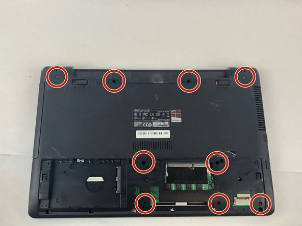 Using the JIS 00 screwdriver, remove the 4.7mm screws that are highlighted, there are two in the battery compartment, two on the outsides of the battery locks, and five around the RAM.