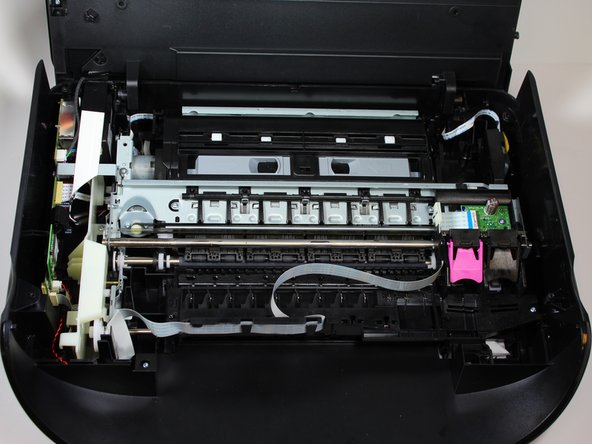Remove the protective cover by lifting it away from the printer with both hands.