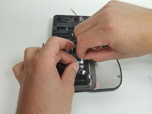 Connect the actuator to the circuit board. Line up the connection and gently push it into place.