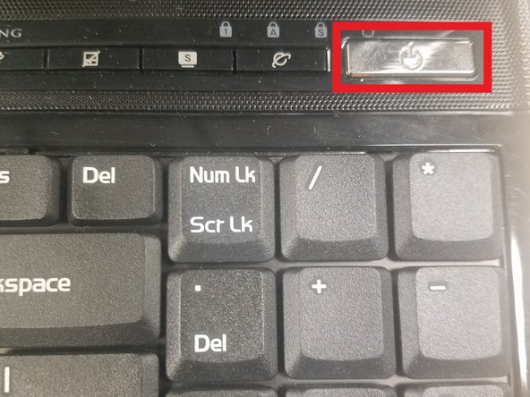 Power off the laptop and flip the laptop upside down.