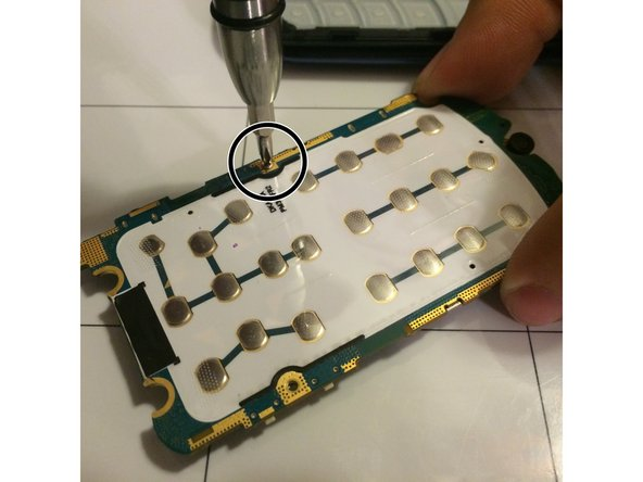 Carefully unscrew the three screws to remove the panel covering the logic board.