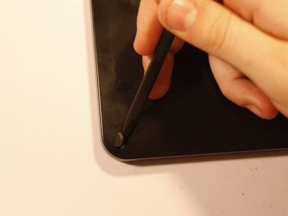 Image 2/3: Using a PH00 screwdriver, remove the 5.8mm screws found beneath each rubber cover (4 total).