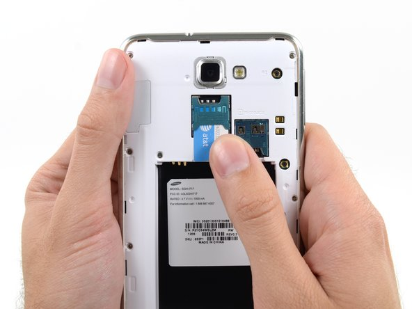 Slide the SIM card out the rest of the way with your thumb and remove it from the device.