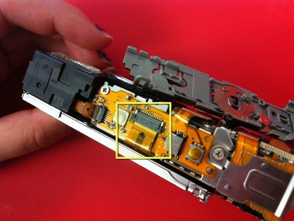 Image 1/1: Insert LCD strip horizontally into port, using tweezers if necessary.