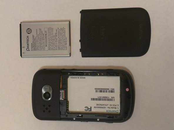 Image 2/2: Then, apply pressure to the battery, pushing up and away from the phone. It will come out easily.