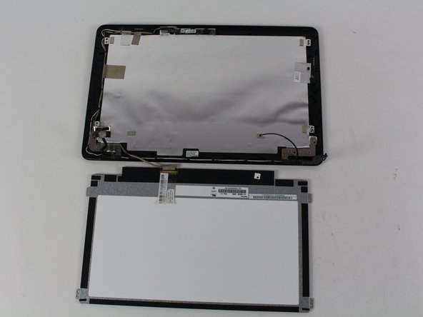 Flip the screen towards the hinge to access the cable connector.