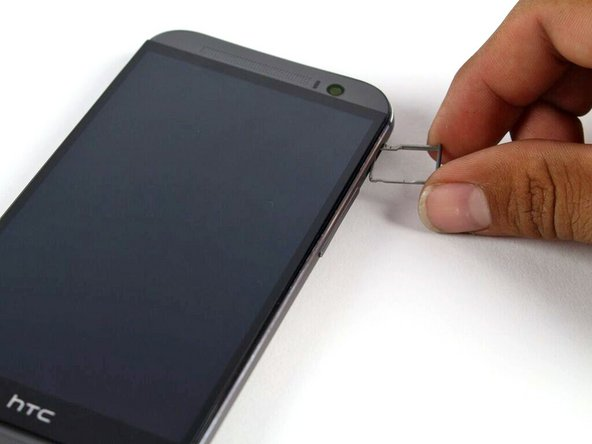 Remove the microSD card tray assembly from the HTC One M8.