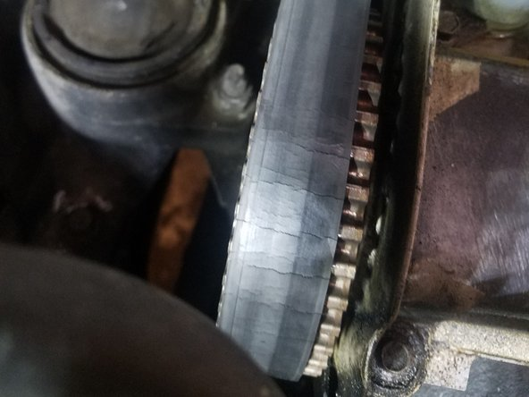 This belt is cracking, indicating it needs to be replaced