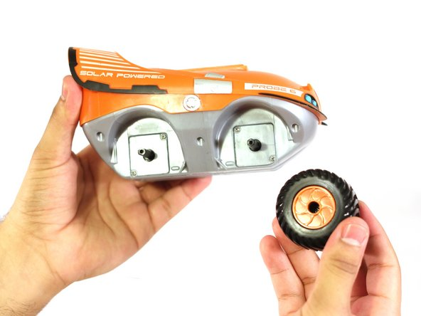 Remove the wheels by pulling them away from the RC car.