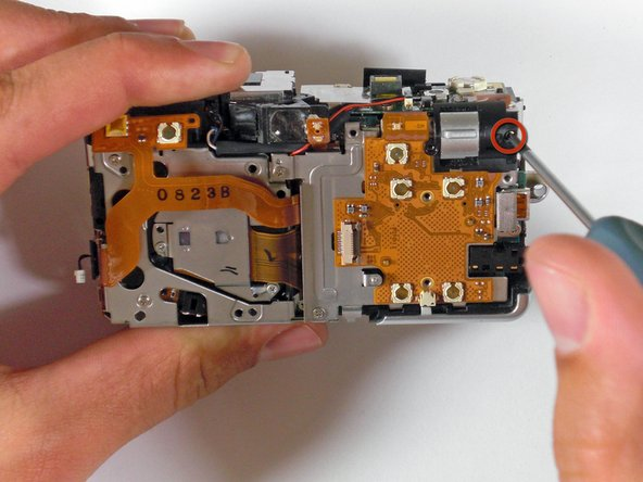 Unscrew the zoom toggle switch and remove.