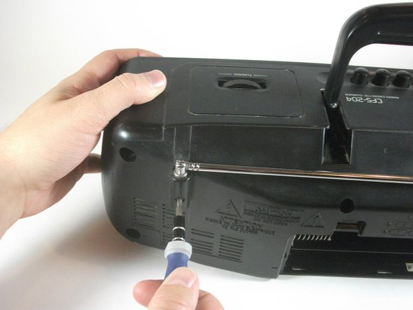 Image 1/1: Loosen and remove the 8 mm screw using the #2 Phillips screw driver.