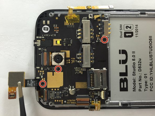 Remove the three 3mm screws on the motherboard using a Phillips #00 screwdriver.