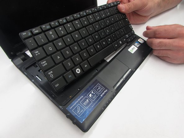Remove the keyboard by gently pulling the top loose, and lifting the keyboard out.
