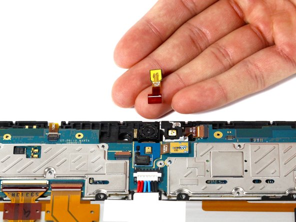 Pull the connector toward the top of the device and remove the front-facing camera.