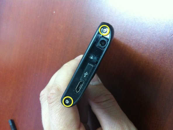 There are six screws to remove from the rear of the phone and two from the top.