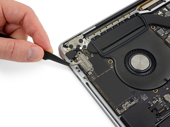 Remove the cover brackets from both Thunderbolt cable sockets.