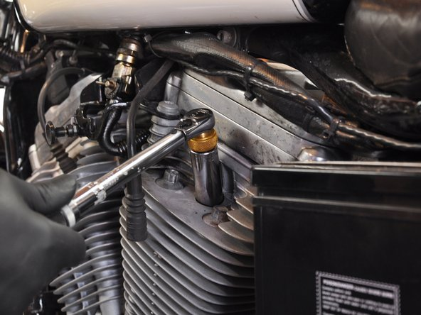 Using a torque wrench, tighten the spark plug to the proper specification.