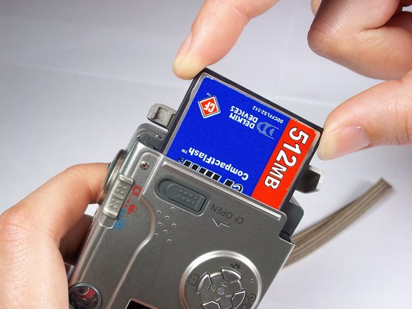Pull the memory card out of the memory card slot.