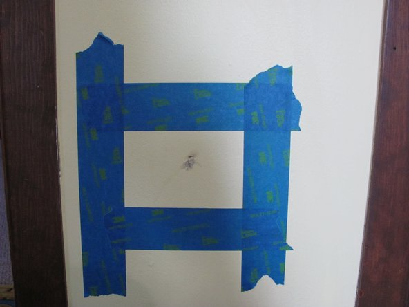 Place painter's tape around the hole so the plaster does not get onto places it does not belong.