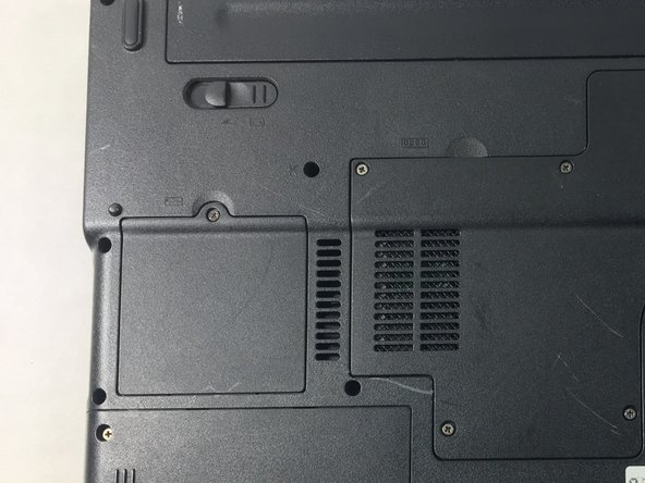 Locate the RAM at the middle left section of the laptop's backside.