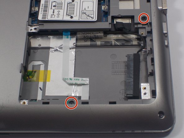 Image 2/2: You are now able to detach the entire back cover of the laptop. You can store these screws in the same area as the others because they are all 1.5 mm, identical parts.