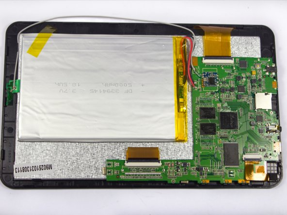 Using new adhesive, apply to the back of the fresh battery and place on device as shown.
