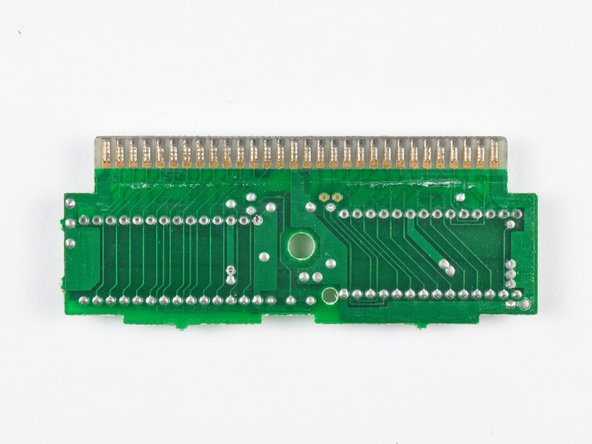 Image 3/3: This PCB from a Tennis cartridge has two ROM packages --  totaling 24 KB -- soldered to one side.